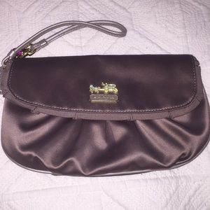 Coach clutch - sand/tan color. Perfect condition.